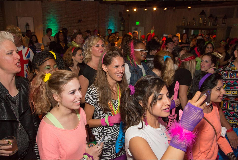 80s themed corporate event entertainment, dancing and costumes