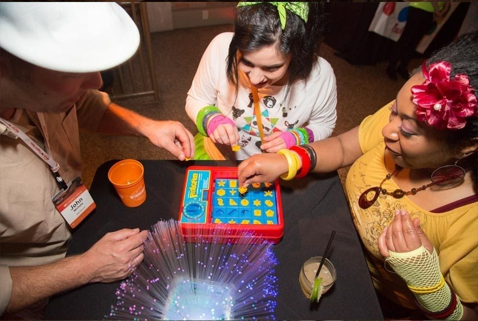 Guests playing games at 80s themed corporate event
