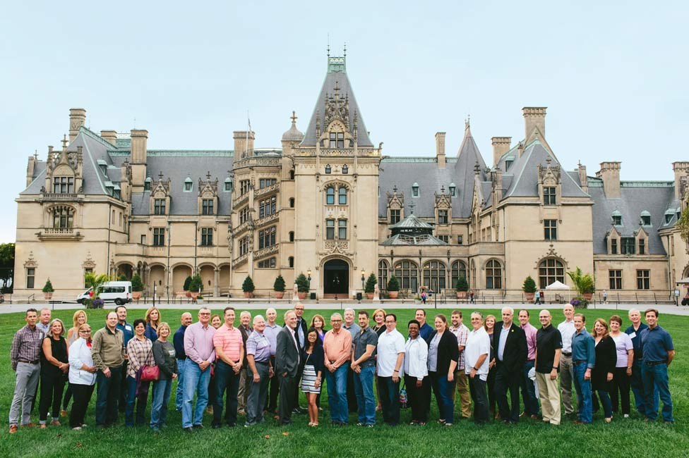 Corporate Group Photo in front of historic Asheville Biltmore House