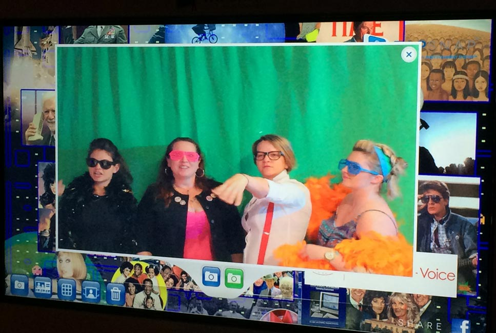 Guests participating in green screen photo booth activity