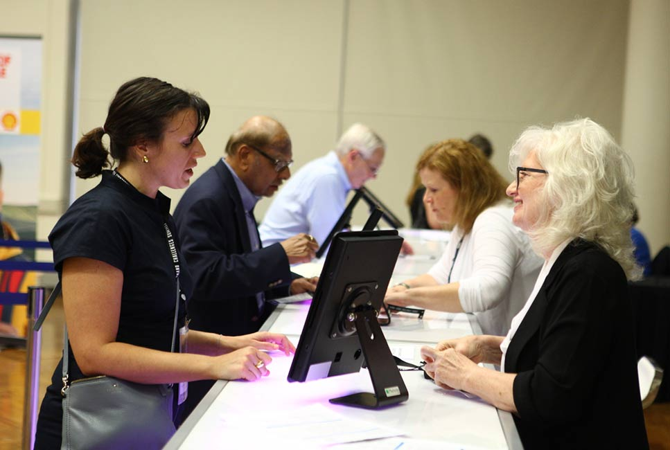 Onsite registration staff helping attendees