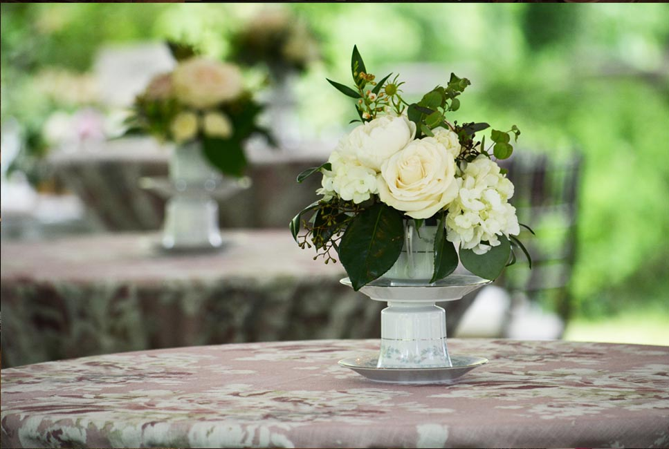 Handmade centerpiece with vintage teacups and roses