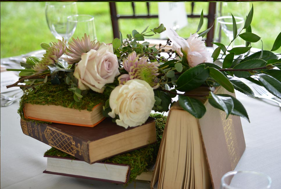 Handmade centerpiece with antique books and roses