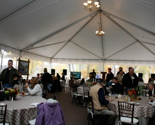Private seated dinner in tent with entertainment