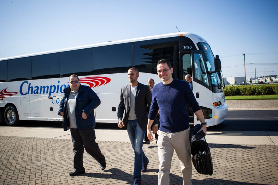 Corporate executives traveling by bus to event